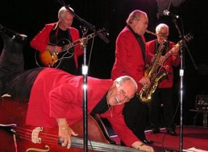 rockabilly slap bassist marshall lytle on the floor with bill haley's original comets
