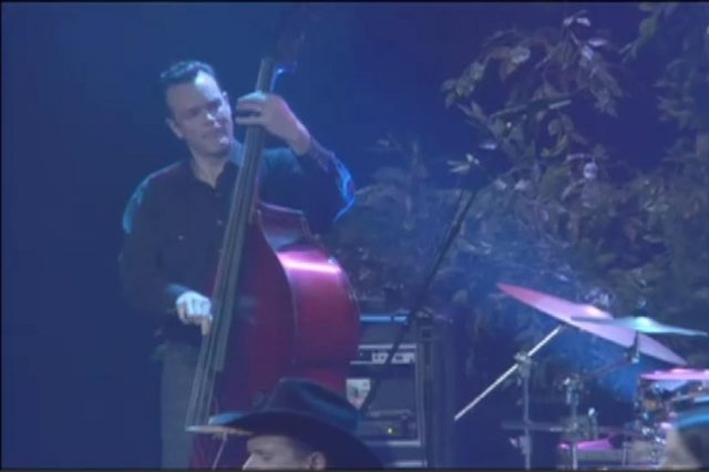 kevin smith from high noon plays upright bass with willie nelson in hesitation blues