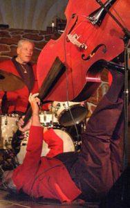 marshall lytle with double bass rockabilly antics on the floor