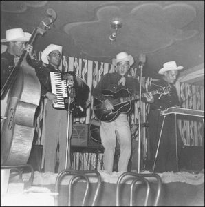 marshall lytle on vocals and acoustic guitar and bill haley on slap bass